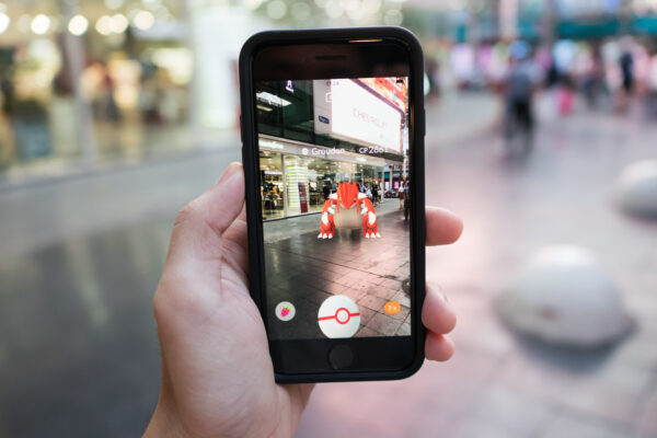 Bangkok, Thailand - December 16, 2017 : iPhone 7 held in one hand showing its screen with Pokemon Go Application.